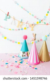 Colorful party hats and cheerful garlands and decorations