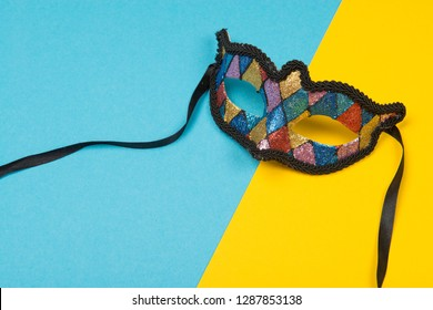 Colorful party mask on a stylish yellow and blue background