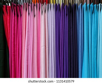 Colorful pashmina scarves arranged by color shades