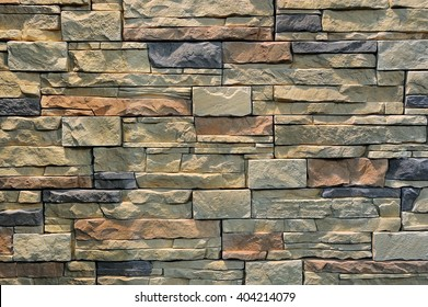 Colorful pattern of decorative brown grey slate stone wall surface, background, texture, pattern