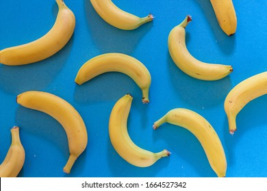 Colorful pattern with fresh bananas on blue background. Wallpaper