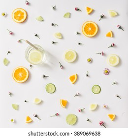 Colorful pattern made of orange, lemon, lime and flowers with lemonade.