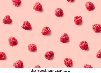 Colorful pattern of raspberries on pink background. Top view