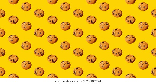 Colorful pattern of sweet cookies on yellow background. Top view. Flay lay