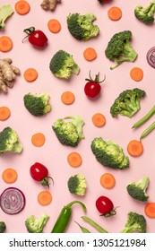 Colorful pattern of tomatoes, broccoli, carrots, ginger and onio