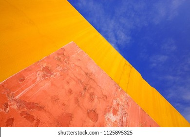 Colorful patterns, plaster walls and sky for the background.