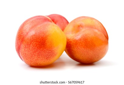Colorful peaches on white background
