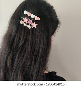colorful pearl heart stars shape hair clips on dark brown bohemian style hair