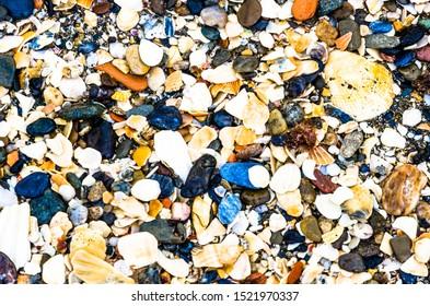 Colorful pebbles on the beach in Marbella Costa del Sol Spain.