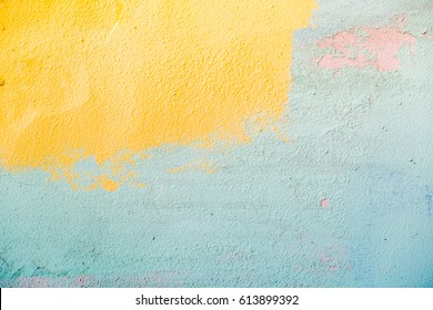 Colorful peeling old painted wall, bright colors, horizontal