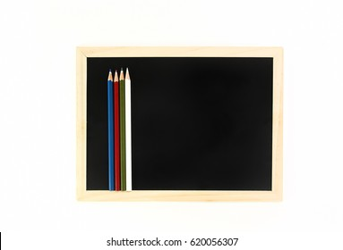 Colorful pencil and blackboard isolated on white background