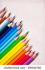Colorful pencil crayons on the background fabric