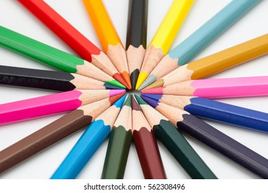 Colorful Pencils Arranged round on white