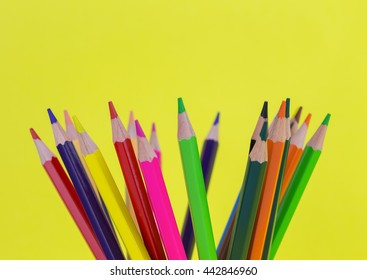 Colorful pencils isolated on background yellow