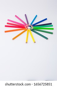 Colorful pencils isolated on white with copy space