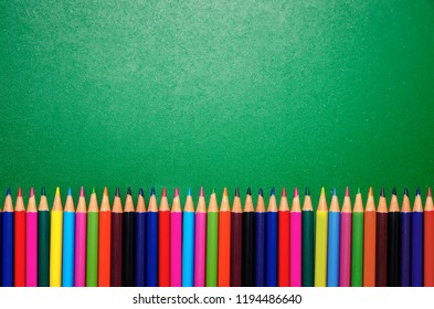 Colorful pencils on blackboard background / copy space