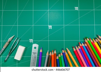 colorful pencils on green cutting mat