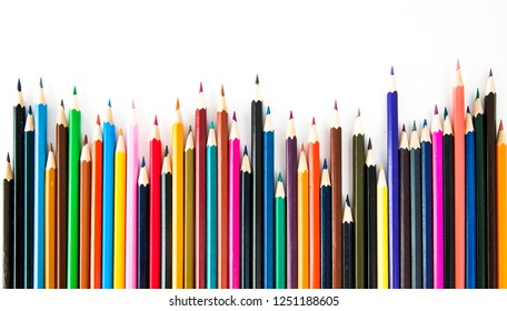 Colorful pencils on white background by artrist