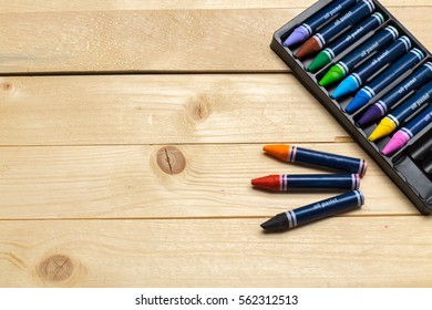 colorful pencils on the wooden table