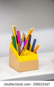 Colorful pencils in a square box. Selective focus.