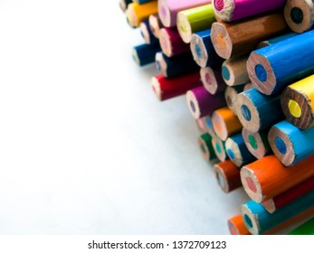 colorful pencils and white paper for drawing