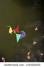 Colorful pennants in the water, wet. Party passed by water, failure.