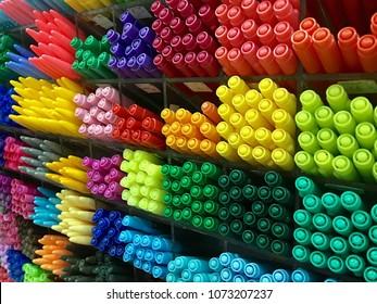 Colorful pens arranged on shelves in shop