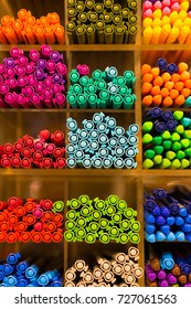 Colorful pens on shelf at store