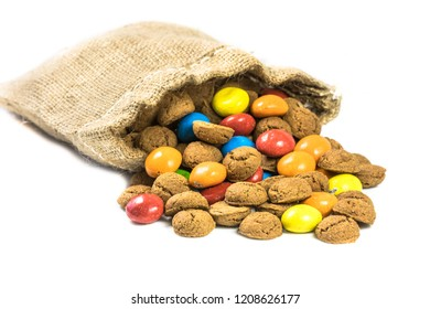 Colorful pepernoten treats in jute bag on white background for annual Sinterklaas holiday event in the Netherlands on december 5th