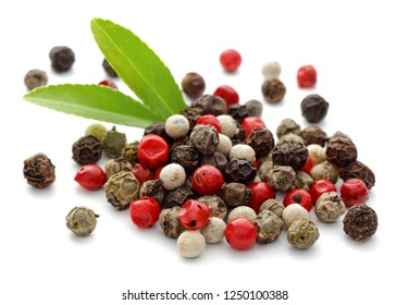 Colorful Peppercorn and leaves isolated on white background