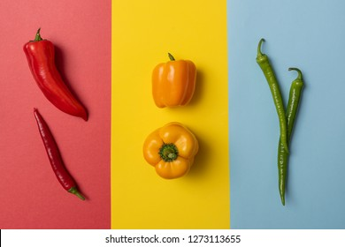 Colorful peppers on colorful background. Yellow, red and green peppers. Peppers background
