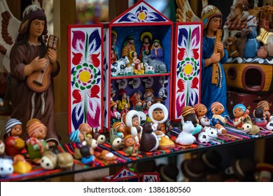 Colorful Peruvian artisanal Retablo for sale at street Indian market in Miraflores, Lima. A traditional devotional handcraft with iconography derived from traditional Catholic church art.