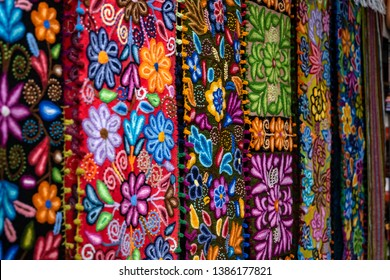 Colorful Peruvian artisanal textiles cloth with inca and traditional patterns for sale at street Indian market in Miraflores, Lima.