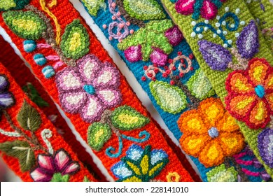Colorful, Peruvian embroided flowers on textile