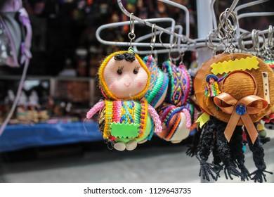 colorful peruvian souvenirs in peru, llaveros, chulos, hats and little dolls.