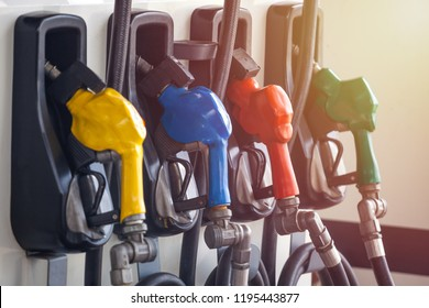 Colorful Petrol pump filling nozzles, Gas station in a service.