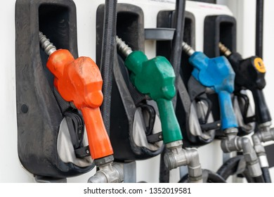 Colorful Petrol pump filling nozzles, Gas station in a service. Industry