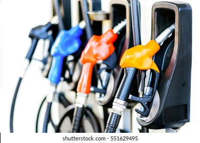Colorful Petrol pump filling  nozzles isolated on white background , Gas station in a service