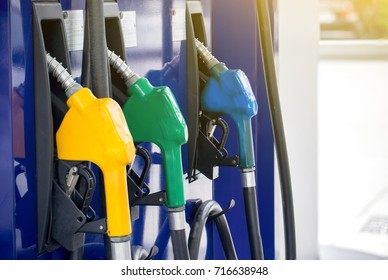 Colorful Petrol pump filling nozzles isolated on white background , Gas station in a service in warm sunset.Head fuel vehicle refueling facility in asia