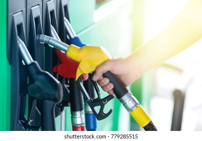A colorful Petrol pump filling nozzles