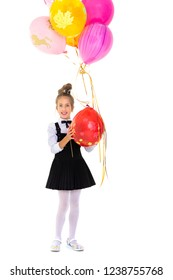 Colorful photo, beautiful girl holding bunch of balloons on white background. The girl is smiling and looking at the camera. Holiday concept, happy childhood.