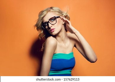 Colorful photo of a blonde woman wearing glasses