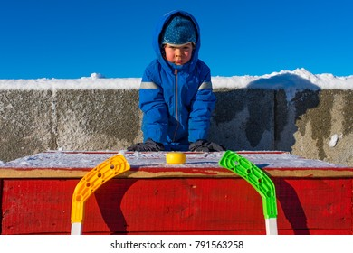 Colorful photo of boy with hockey sticks