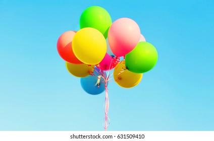 Colorful photo bundle air balloons on a blue sky