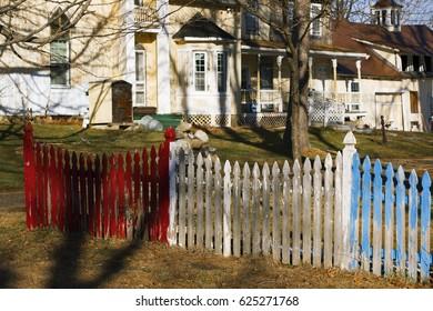 Colorful picket fence on a farmland.