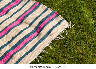 colorful picnic blanket on the grass field