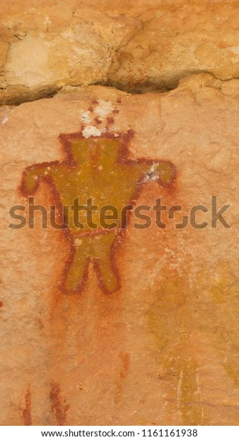Colorful pictograph rock art painted by the the Basketmaker culture on rock cliff walls in Snake Gulch Canyon, Arizona, USA.