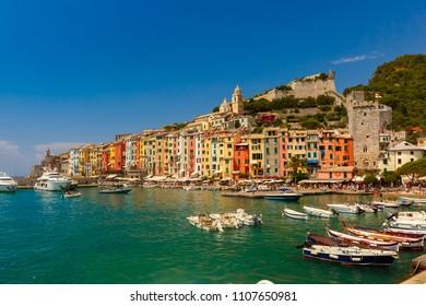 Colorful picturesque harbour of Porto Venere with San Lorenzo church, Doria Castle and Gothic Church of St. Peter, Italian Riviera, Liguria, Italy.