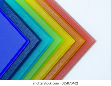 Colorful pieces of matte plexiglass. Isolated on white background.