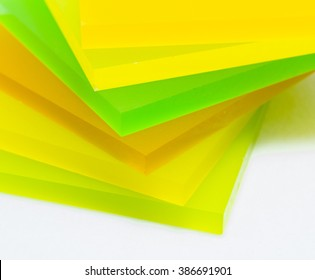 Colorful pieces of Plexiglas isolated on white background.